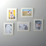 Unpainted, natural wooden set of five picture frame decor mounted on a wall made with chip-free plexiglass with CRAFT by Wallniture.