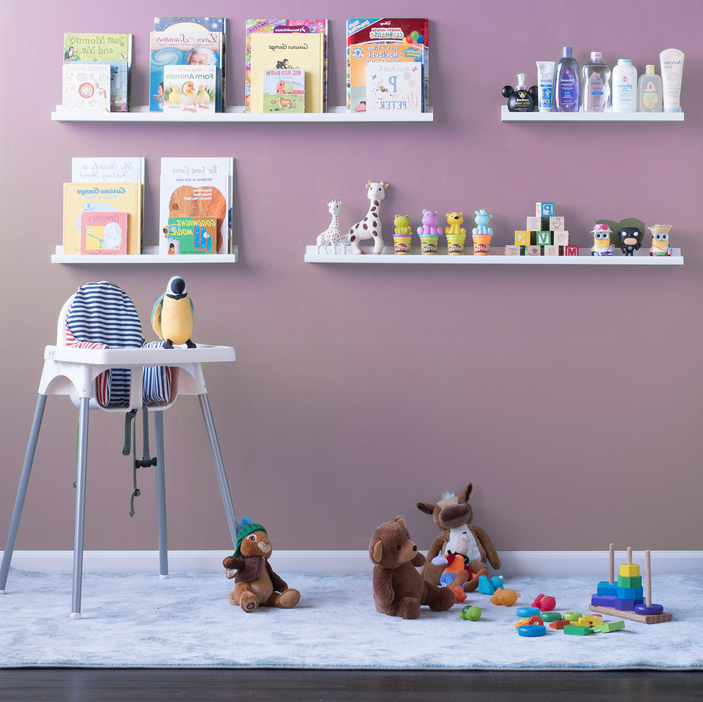 Nursery room with toddler high chair, toys on the ground, and nursery books being stored on BOSTON wooden shelves by Wallniture.