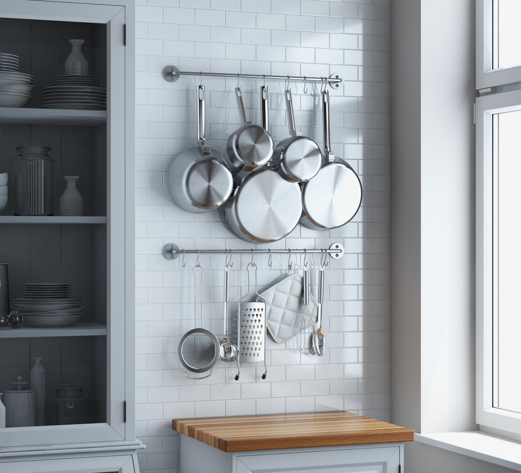 A kitchen; pots, pans and kitchenware held by CUCINA Metal Rail by Wallniture.