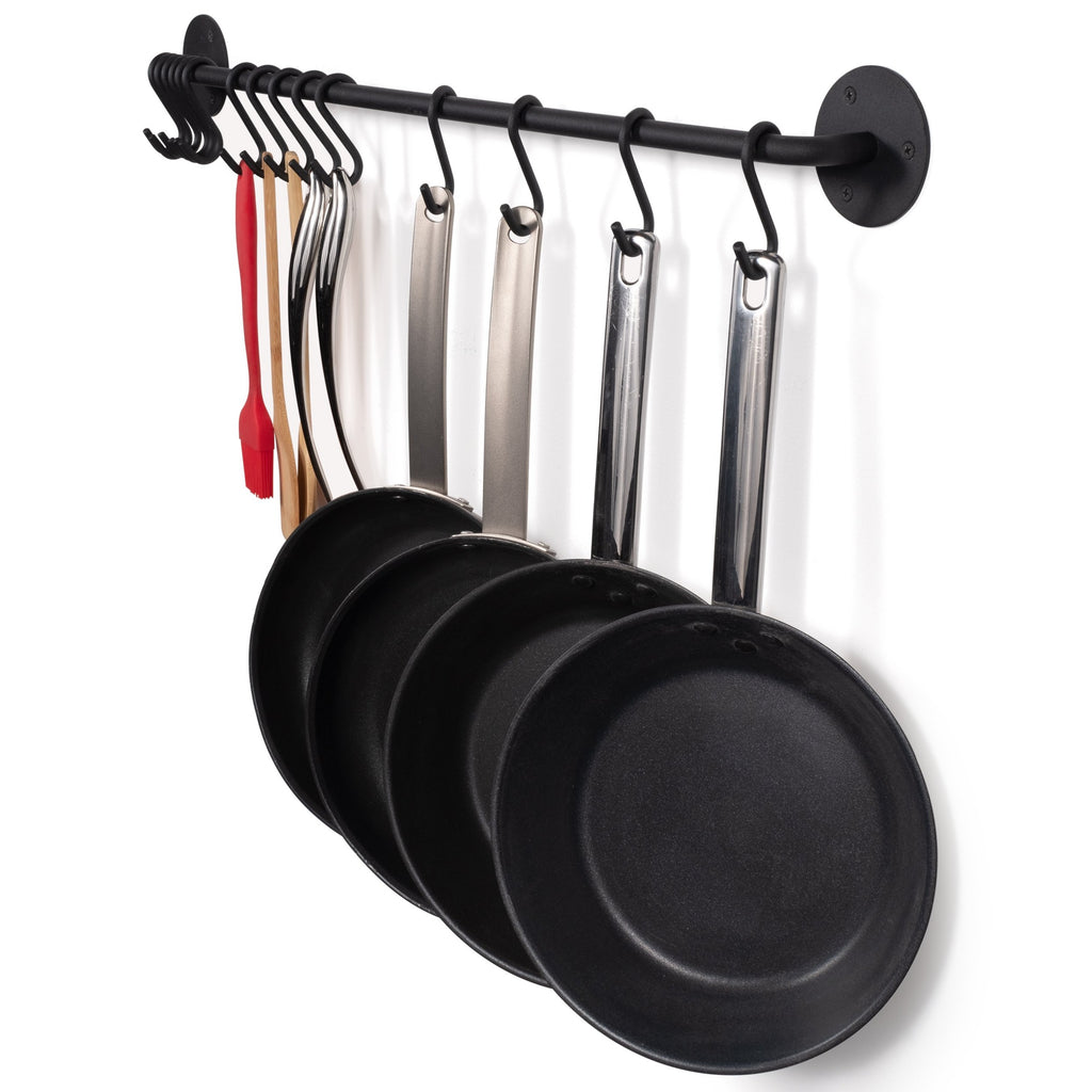 Kitchenware; pans, spoons and spatulas being held by DELUX Rail and Hooks by Wallniture.