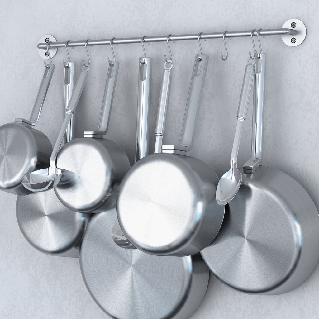 A kitchen; pots and pans held by CUCINA Metal Rail by Wallniture.