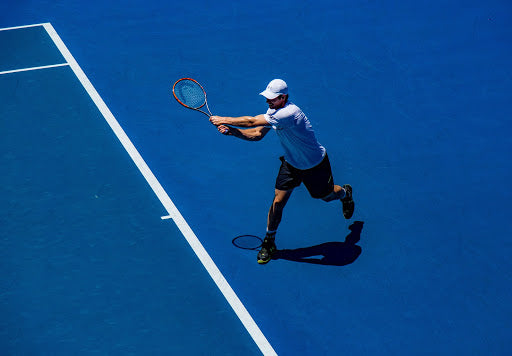 Image of man playing tennis.