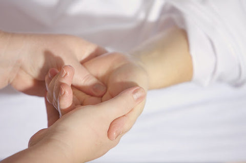 What To Do If You Have Repetitive Stress Injuries Photo- Image of hand pressing hand.