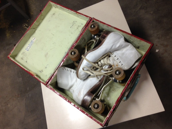 Set of Vintage woman's roller skates in original carrying case
