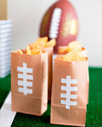 decorate brown bags with football laces