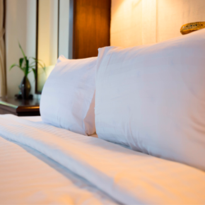 image of a bed with crisp sheets