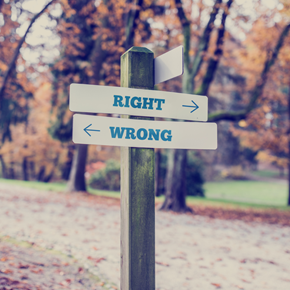 signposts signifying right and wrong ways