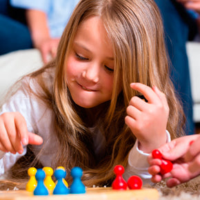 child playing board game