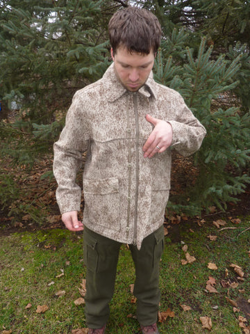 WeatherWool All Around Jacket in Lynx Pattern with front double zipper completely closed and storm flap pulled back