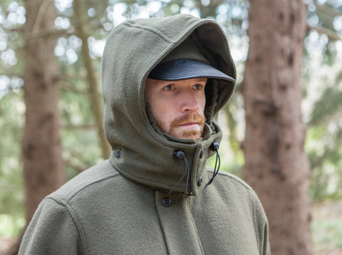 WeatherWool All Around Jacket in Solid Drab Color with Double Hood Up and worn over a Ball Cap