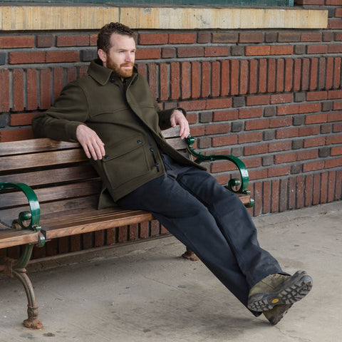 WeatherWool All Around Jac in Solid Drab Color, seated at train station, South Orange, New Jersey