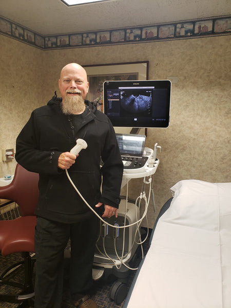 Jim McCullough is an Ultrasound Technician who wears his WeatherWool Anorak while working in a hospital.