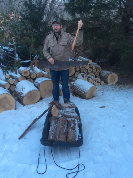 WeatherWool Advisor Mike Dean bucking and splitting firewood with hand tools in his MidWeight ShirtJac in temperature of about 18F/-8C