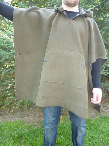 WeatherWool Poncho in Solid Drab Color with Arm Extended to show width of Poncho