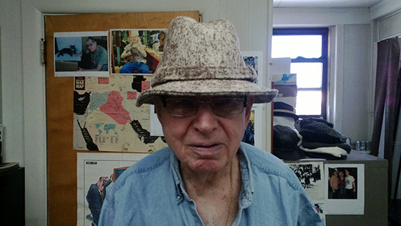 For several years, all WeatherWool Hats were made by Ruby Spitz, an amazing guy and it was our privilege to know him. Ruby didn't like me taking his picture, so one photo was taken when he wasn't aware, and the other when he was scowling at me!