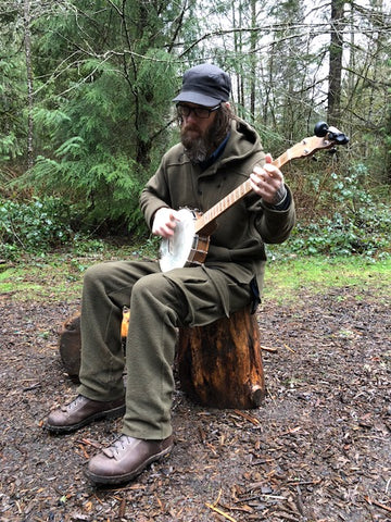 Advisor Tom Brown plays Banjo in WeatherWool Pants and Al's Anorak