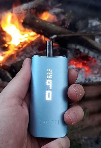 Enjoying the DaVinci IQ 2 Vaporizer by a fireplace