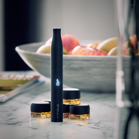 Dr. Dabber Stella Concentrate Vaporizer on table with material