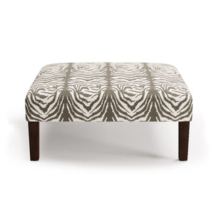 An English country house staple, the Cocktail Ottoman is foot stool and coffee table combined. It exudes coziness while remaining every bit chic.The Cocktail Ottoman is available in linen and velvet