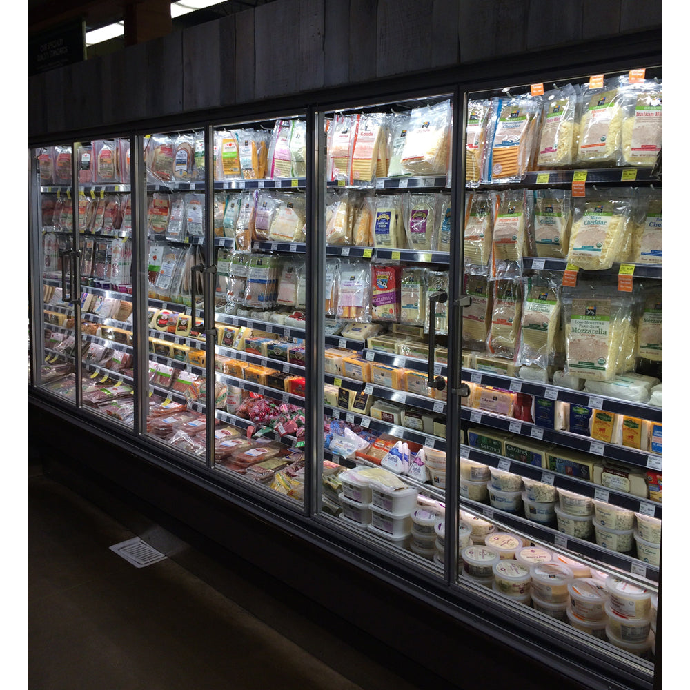 Glass refrigeration doors installed by Remis America at Whole Foods Market similar to Anthony Glass Door system