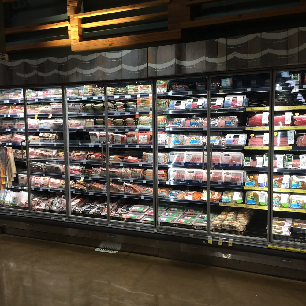 Remis America Glass Door installation at Whole Foods Market similar to Anthony Glass Door System
