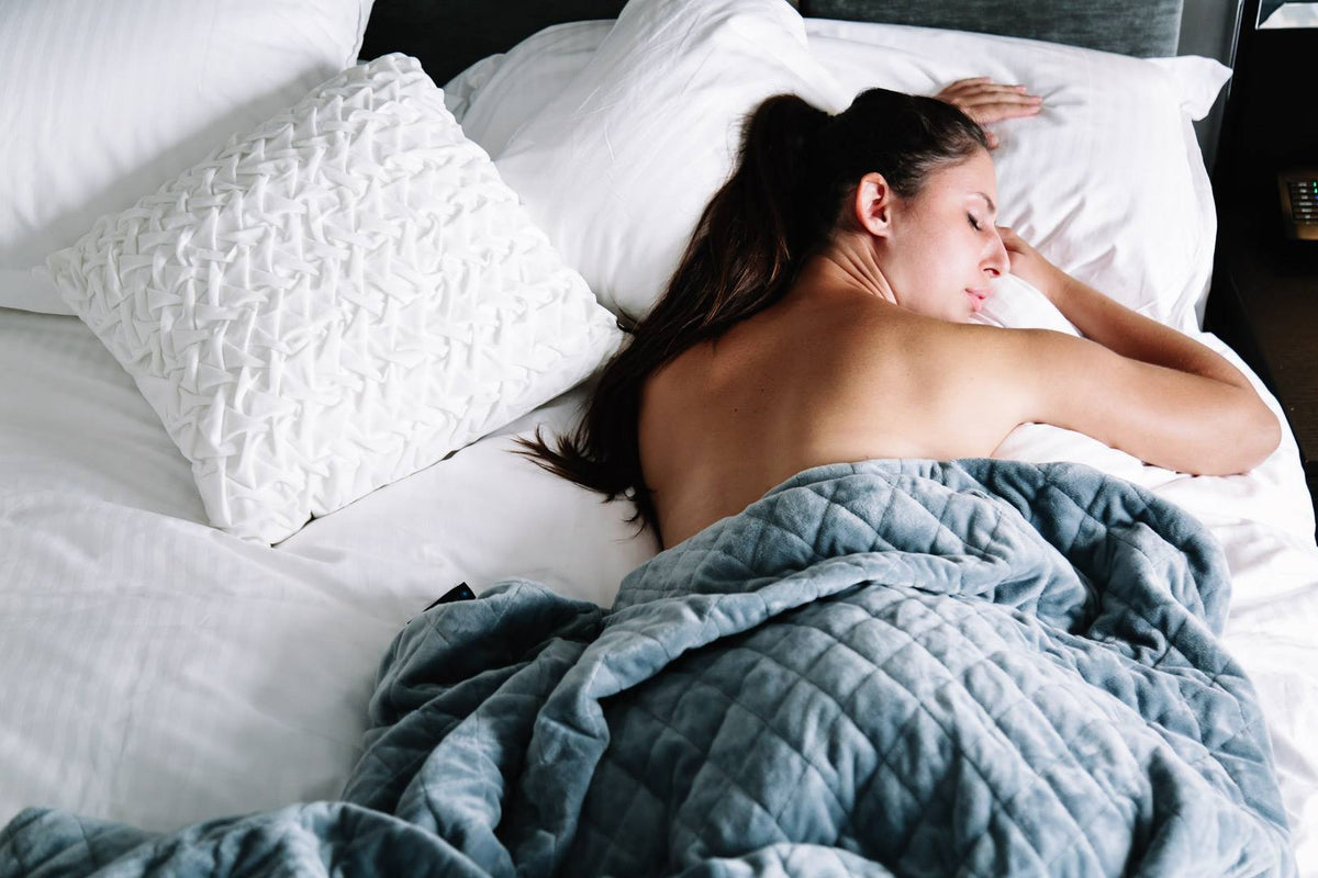 woman sleeping with neptune weighted blanket