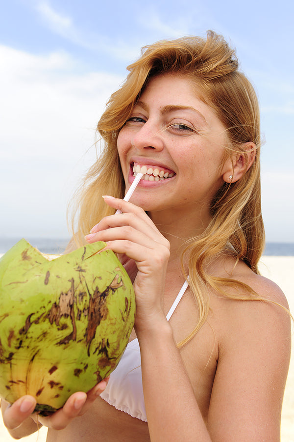 girl drinking a coconut