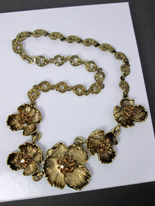 antique gold flower metal sculpture necklace