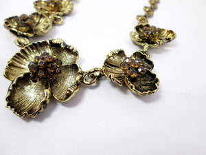 antique gold flower necklace closeup