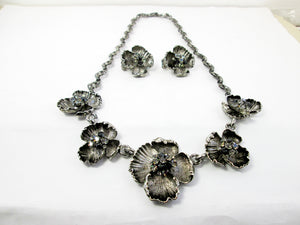 antique silver flower sculpture bib necklace and clip on earrings set