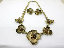 Load image into Gallery viewer, antique gold flower sculpture bib necklace and clip on earrings set