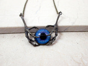 vintage style dragon claws holding eye necklace