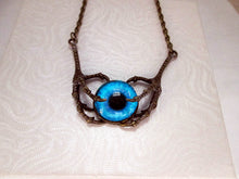 Load image into Gallery viewer, dragon claws with a glow in the dark eye necklace