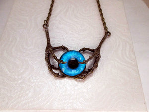 dragon claws with a glow in the dark eye necklace