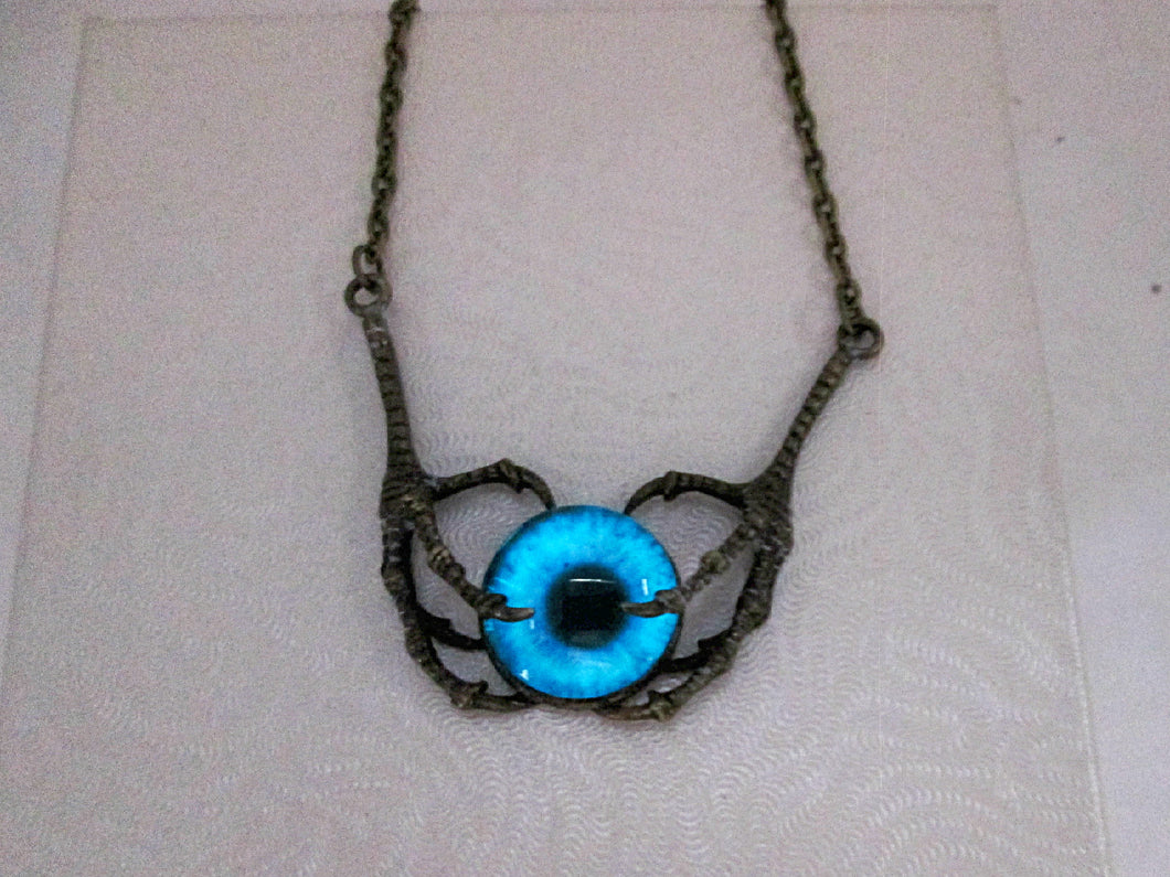 glow in the dark claw eye pendant necklace