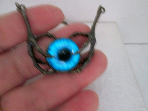glowing eye claw neckalce