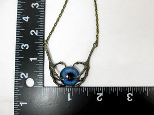 dragon claw and glowing eye necklace with measurement