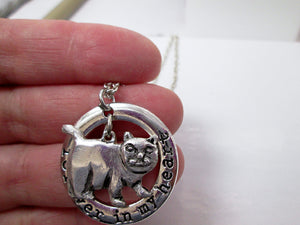 chubby cat pendant close up view