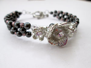 fancy silver flower magnetic bracelet with purple beads