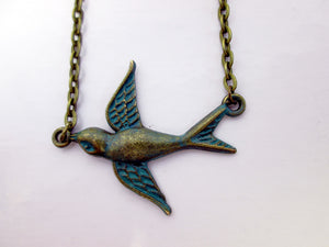 small flying bird necklace