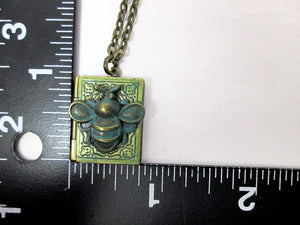 antique style book locket with measurement
