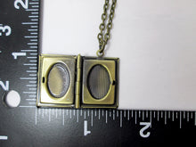 Load image into Gallery viewer, inside view of small book locket