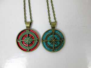 red or blue compass necklace