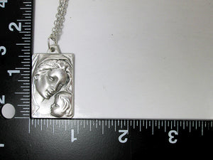 Madonna and Child pendant with measurement