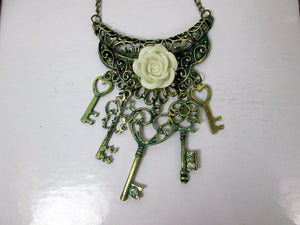 beige rose keys bib necklace