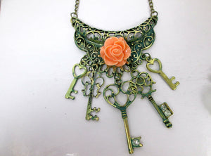 pink rose keys bib necklace