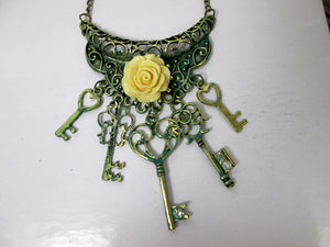 yellow rose keys bib necklace