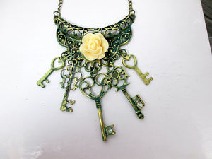 peachy rose keys bib necklace