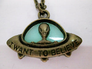green glowing spaceship necklace