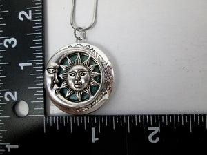 moon and sun locket with measurement